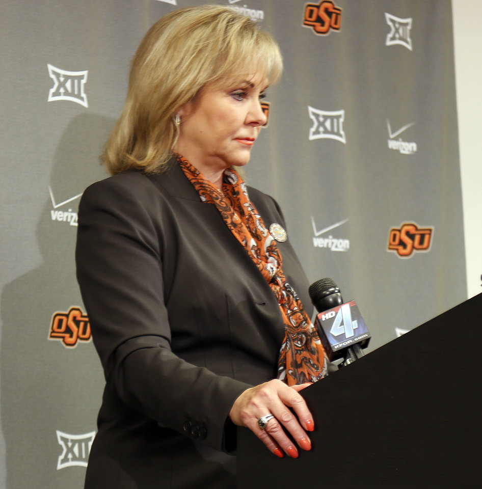 Photo - Gov. Mary Fallin talk to the media during half time of a college football game between the Oklahoma State University Cowboys (OSU) and the Kansas Jayhawks (KU) at Boone Pickens Stadium in Stillwater, Okla., Saturday, Oct. 24, 2015. Photo by Sarah Phipps, The Oklahoman