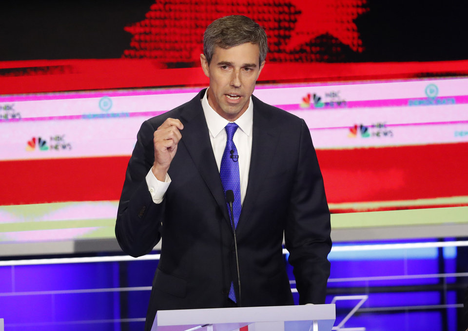 Photo - Democratic presidential candidate former Texas Rep. Beto O'Rourke speaks at a Democratic primary debate hosted by NBC News at the Adrienne Arsht Center for the Performing Art, Wednesday, June 26, 2019, in Miami. (AP Photo/Wilfredo Lee)