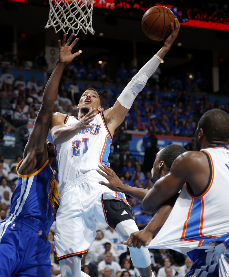 Photo - Oklahoma City's Andre Roberson (21) goes to the basket during Game 3 of the Western Conference finals in the NBA playoffs between the Oklahoma City Thunder and the Golden State Warriors at Chesapeake Energy Arena in Oklahoma City, Sunday, May 22, 2016. Oklahoma City won 133-105. Photo by Bryan Terry, The Oklahoman
