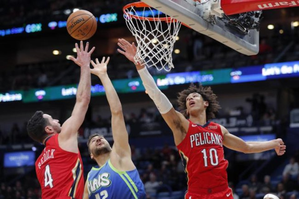 Photo -  Dallas Mavericks forward Maxi Kleber (42) battles under the basket with New Orleans Pelicans guard JJ Redick (4) and center Jaxson Hayes (10) during Tuesday night's game in New Orleans. [AP Photo/Gerald Herbert]
