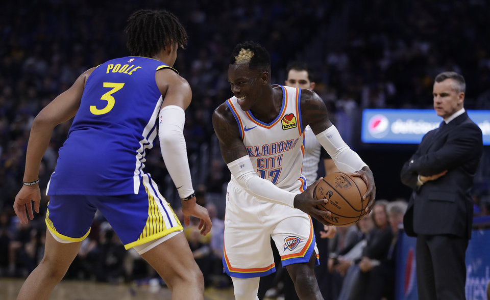 Photo - Oklahoma City Thunder guard Dennis Schroder, right, drives the ball against Golden State Warriors' Jordan Poole (3) during the first half of an NBA basketball game Monday, Nov. 25, 2019, in San Francisco. (AP Photo/Ben Margot)