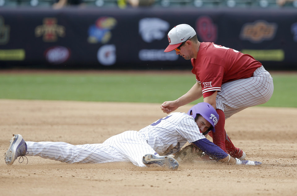 Photo - Oklahoma's Conor McKenna tags TCU's Bobby Goodloe at second base but McKenna advanced on a walk in the fourth inning of a Big 12 baseball tournament game between the University of Oklahoma (OU) and TCU at Chickasaw Bricktown Ballpark in Oklahoma City, Okla., Thursday, May 23, 2019.  [Bryan Terry/The Oklahoman]