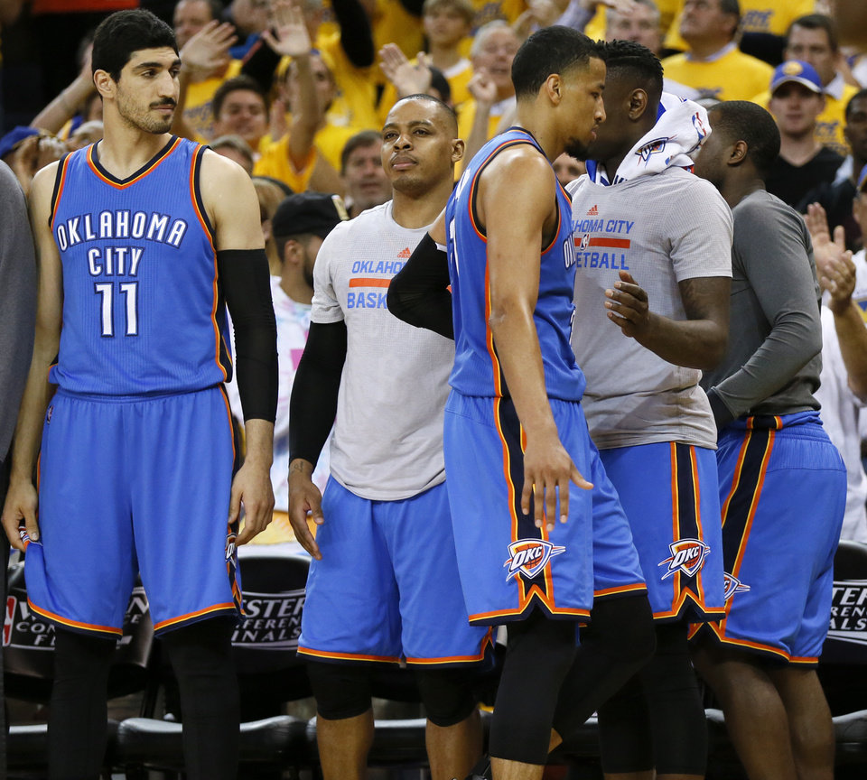 Photo - Oklahoma City's Andre Roberson (21) walks through the Thunder bench after fouling out in Game 5 of the Western Conference finals in the NBA playoffs between the Oklahoma City Thunder and the Golden State Warriors at Oracle Arena in Oakland, Calif., Thursday, May 26, 2016. The Warriors won 120-111. Photo by Nate Billings, The Oklahoman