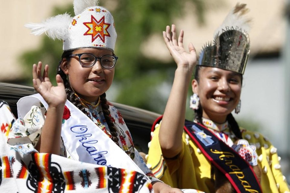 Photo - A tribal princess waves to the crowd during the 2019 Red Earth Festival Parade in downtown Oklahoma City, Oklahoma Saturday, June 8, 2019.  [Paxson Haws/The Oklahoman]