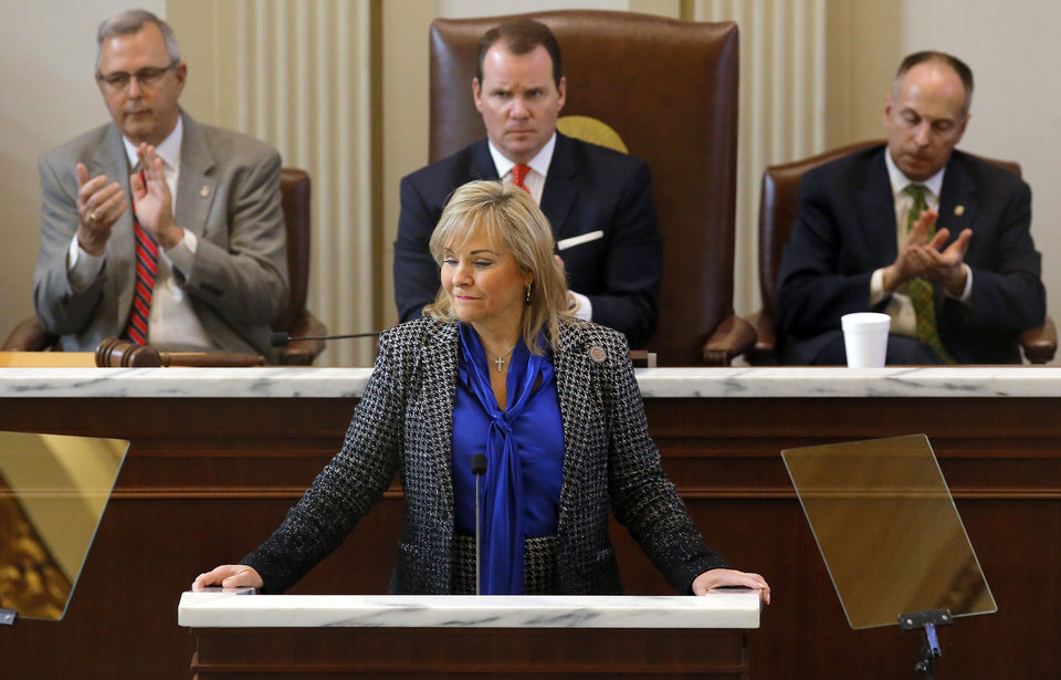 Photo - Senate President Pro Tempore Brian Bingman, Lt. Todd Lamb and Speaker of the House Jeffery Hickman, back from left, clap as Gov. Mary Fallin speaks during the Oklahoma Legislature's 2016 State-of-the-State Address by Gov. Mary Fallin in the chamber of the House of Representatives at the Oklahoma state capitol on Monday, Feb. 1, 2016, in Oklahoma City, Okla. Photo by Jim Beckel, The Oklahoman