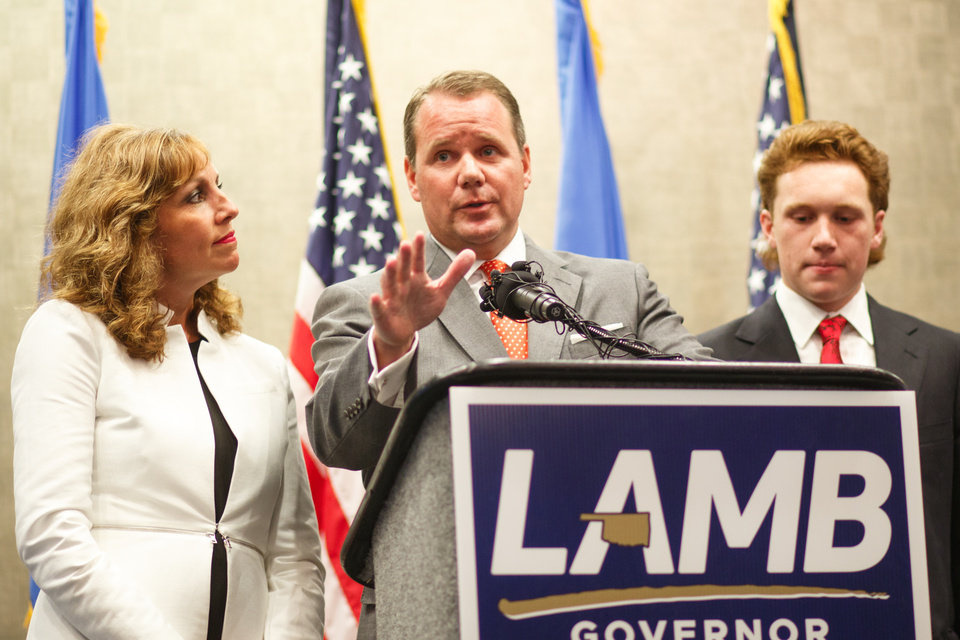 Photo - Lt. Gov. Todd Lamb gives a concession speech at his election watch party at the Renaissance Waterford Oklahoma City Hotel in Oklahoma City, Tuesday, June 26, 2018. He is accompanied by his wife Monica and his son Griffin. Photo by Anya Magnuson, The Oklahoman