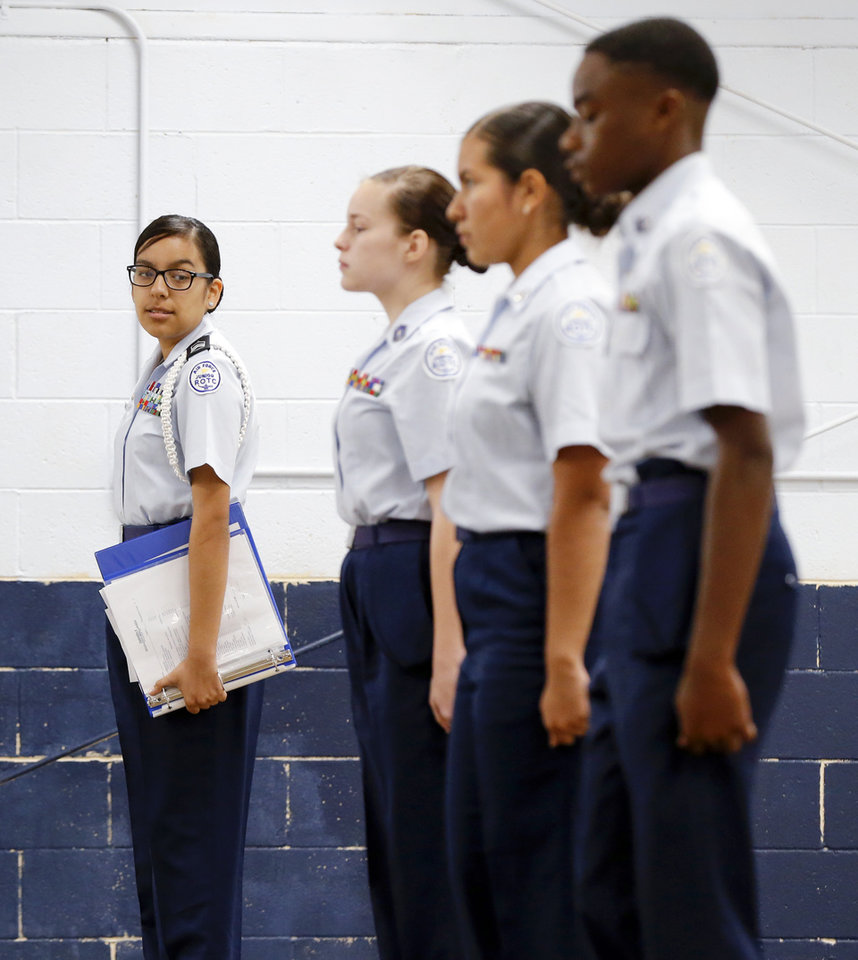 Photo -  Cadet Daisy Moreno, 16, a junior, leads the drill team during practice. [Photo by Nate Billings, The Oklahoman]