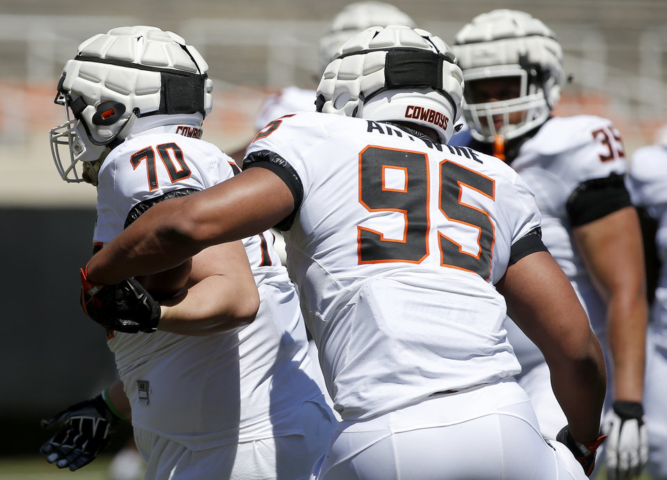 Photo - OSU's Israel Antwine (95) and Kevin Mair (70) run through drills during the Oklahoma State Cowboys spring practice at Boone Pickens Stadium in Stillwater, Okla., Saturday, April 20, 2019.  Photo by Sarah Phipps, The Oklahoman