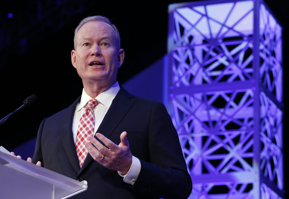 Photo - Mayor Mick Cornett gives his annual state of the city address at the Cox Convention Center on Thursday, Jan. 18, 2018 in Oklahoma City, Okla.  Photo by Steve Sisney, The Oklahoman