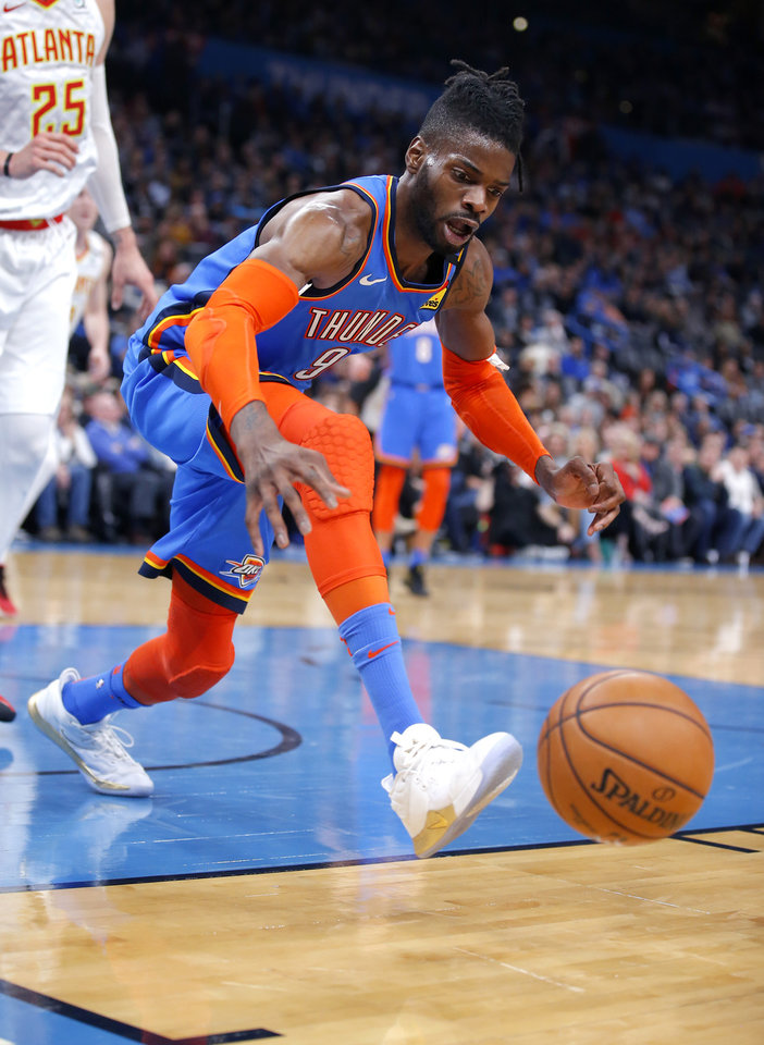 Photo - Oklahoma City's Nerlens Noel (9) tries to get a loose ball during the NBA basketball game between the Oklahoma City Thunder and the Atlanta Hawks at the Chesapeake Energy Arena in Oklahoma City,Friday, Jan. 24, 2020.  [Sarah Phipps/The Oklahoman]