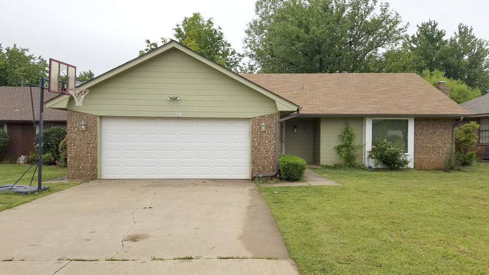 Photo - This May 1, 2019 photo shows the Edmond, Okla. home where police say a naked 17-year-old high school student, Isaiah Mark Lewis, was fatally shot Monday, after forcing his way inside. Police in the Oklahoma City suburb say two officers, Sgt. Milo Box and Officer Denton Scherman were not wearing body cameras when at least one of them fatally shot the unarmed teenager. Box has worked at the department for 17 years, and Scherman was hired in September. (AP Photo/Ken Miller)