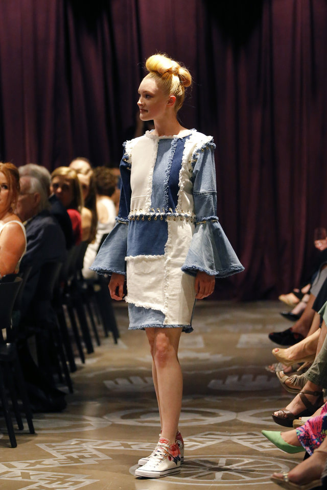 Photo -  OSU designer Bingyue Wei's line of apparel is composed of four upcycled denim pieces, each featuring adaptations that transform the original into a completely different piece of clothing, such as a dress into a skirt, or a sleeved to sleeveless top. [PHOTO BY BRYAN TERRY, THE OKLAHOMAN]