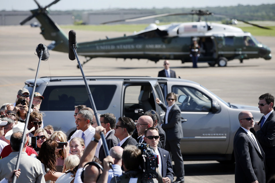 Photo - President Barack Obama is greeted by persons attending his arrival at the North Texas Regional Airport in Denison, Texas, July 15, 2015. (AP Photo/Tony Gutierrez)
