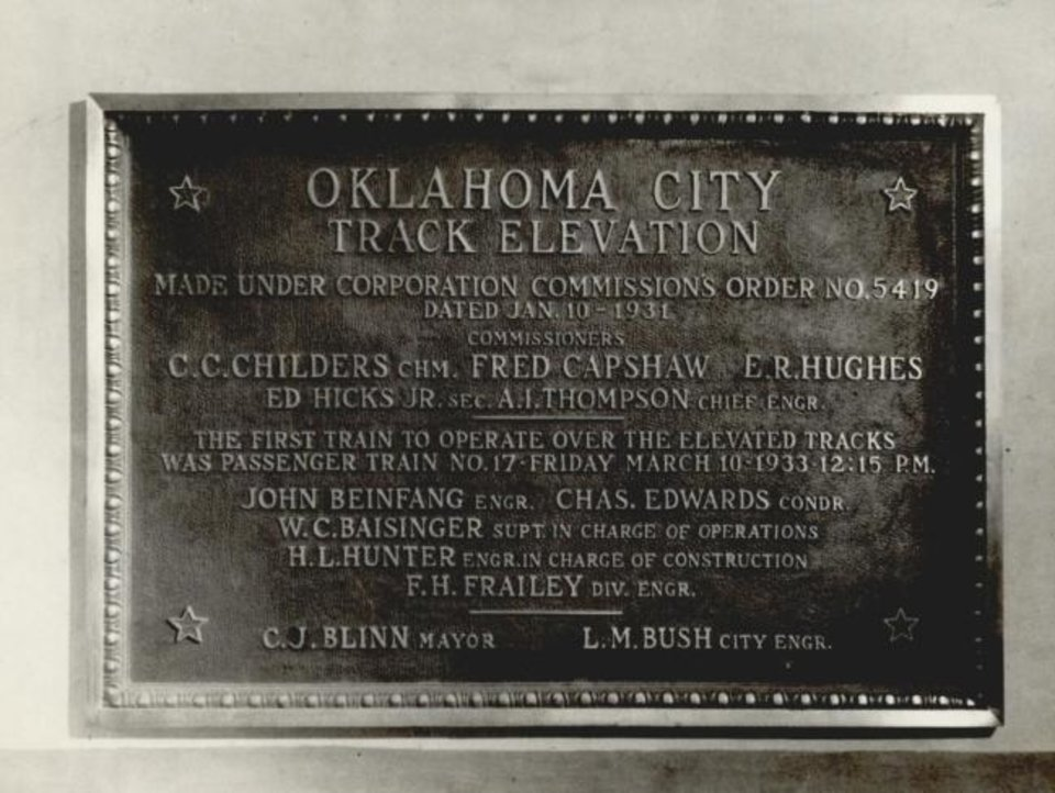 Photo -  A commemorative plaque pictured in 1934 marks the Santa Fe project to elevate its downtown tracks in Oklahoma City. [THE OKLAHOMAN ARCHIVES]