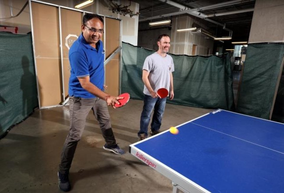 Photo -  Gaurav Kumar, left, and Bob Axtell enjoy a game of table tennis in the OMRF tower. [STEVE SISNEY/THE OKLAHOMAN]