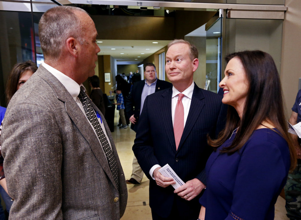 Photo - Republican gubernatorial candidate Mick Cornett and wife Terri, right, speak with Owen Canfield before participating in a forum for candidates at the Oklahoma City Museum of Art on Monday, April 23, 2018 in Oklahoma City, Okla.  Photo by Steve Sisney, The Oklahoman