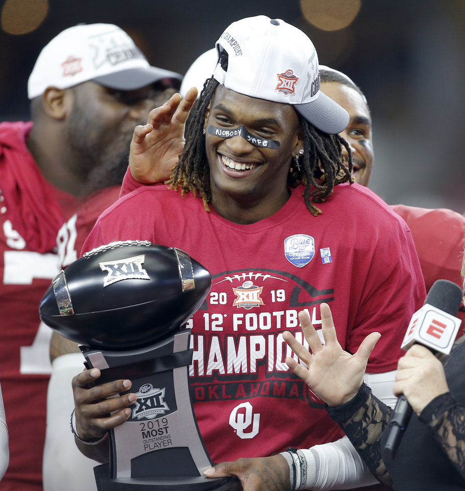 Photo - Oklahoma's CeeDee Lamb (2) holds the Most Outstanding Player Trophy during the Big 12 Championship Game between the University of Oklahoma Sooners (OU) and the Baylor University Bears at AT&T Stadium in Arlington, Texas, Saturday, Dec. 7, 2019. Oklahoma won 30-23. [Bryan Terry/The Oklahoman]