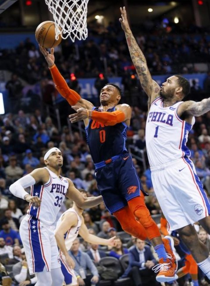 Photo -  Oklahoma City's Russell Westbrook, center, tries to score between Philadelphia's Mike Scott, right, and Tobias Harris during Thursday night's game at Chesapeake Energy Arena. [Nate Billings, The Oklahoman]