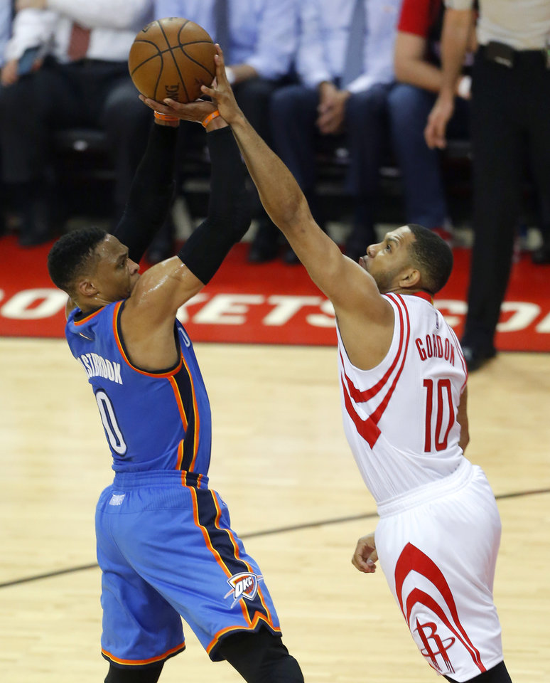 Photo - Houston's Eric Gordon (10) blocks the shot of Oklahoma City's Russell Westbrook (0) during Game 2 in the first round of the NBA basketball playoffs between the Oklahoma City Thunder and the Houston Rockets at the Toyota Center in Houston, Texas,  Wednesday, April 19, 2017.  Photo by Sarah Phipps, The Oklahoman