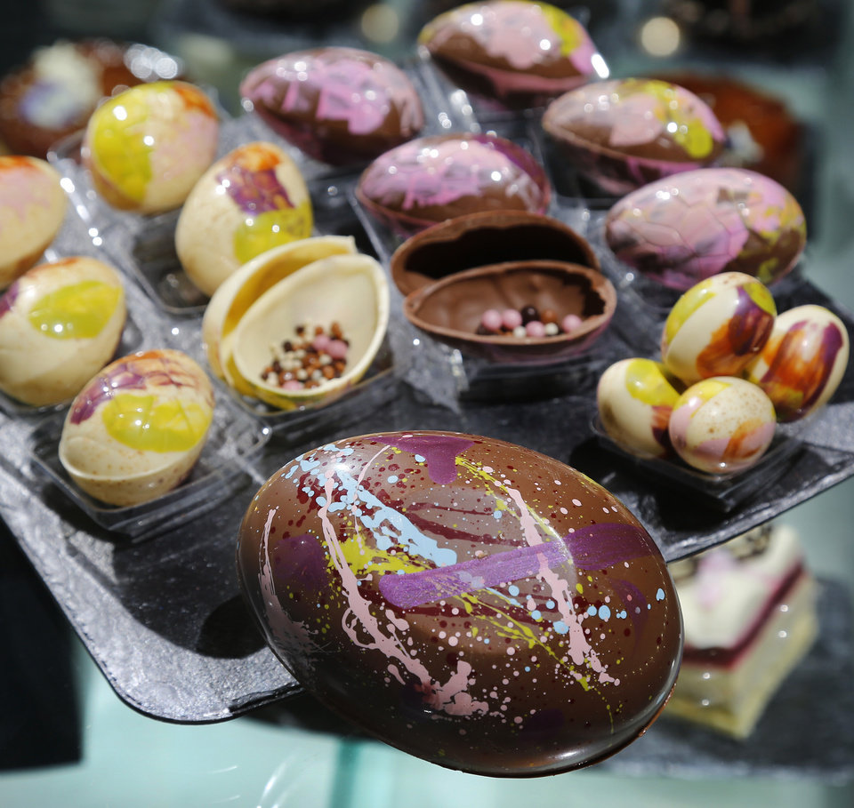 Photo -  Chocolate eggs filled with made-from-scratch candies are displayed at Ganache Patisserie on Monday.