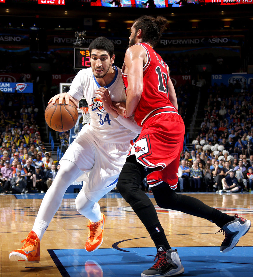Photo - Oklahoma City's Enes Kanter (34) tries to get by Chicago's Joakim Noah (13) during the NBA game between the Oklahoma City Thunder and the Chicago Bulls at Chesapeake Energy Arena in Oklahoma City, Sunday, March  15, 2015. Photo by Sarah Phipps, The Oklahoman