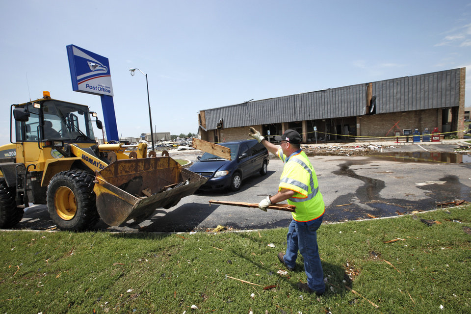 Photo - ODTO worker clear the area around the Moore Post Office destroyed in the May 20th tornado, Thursday, May 23, 2013.  Photo by David McDaniel, The Oklahoman