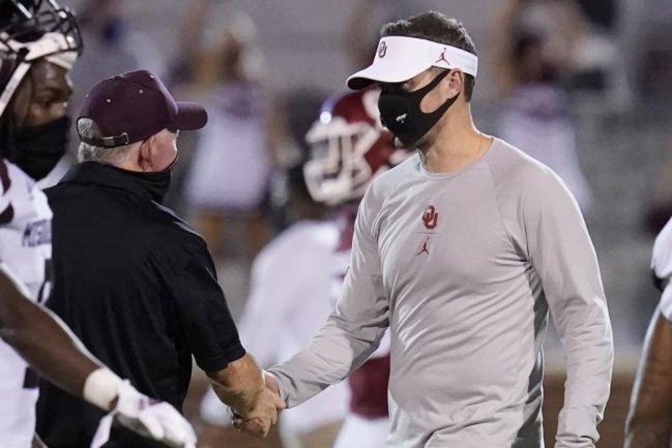Photo -  Missouri State coach Bobby Petrino, left, and Oklahoma coach Lincoln Riley, right, shake hands after the Sooners' 48-0 win on Sept. 12. [Sue Ogrocki/AP PHOTO]