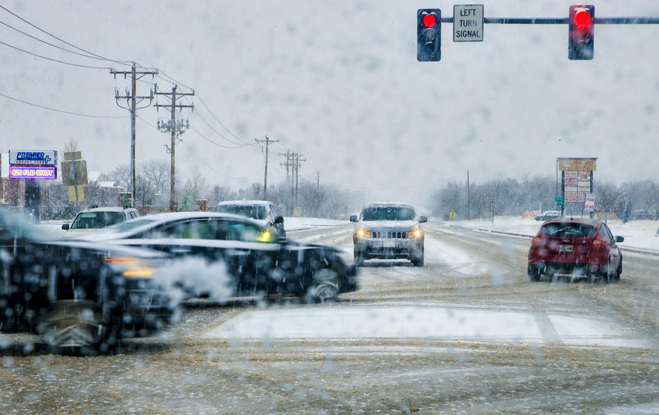 Photo - Traffic navigates the roadway as  a winter storm makes its way through Oklahoma City, Okla. on Thursday, Jan. 3, 2019. Photo by Chris Landsberger, The Oklahoman