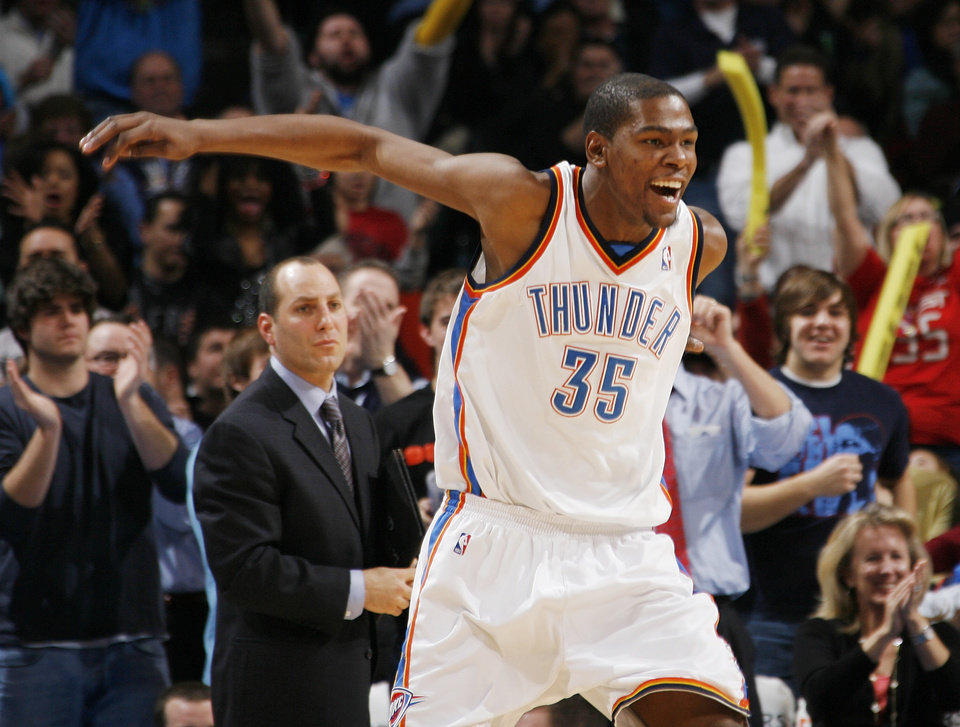 Photo - Oklahoma City's Kevin Durant (35) reacts from the bench after a score by the Thunder in the third quarter during the NBA basketball game between the Dallas Mavericks and the Oklahoma City Thunder at the Ford Center in Oklahoma City, Tuesday, Feb. 16, 2010. Oklahoma City won, 99-86. Photo by Nate Billings, The Oklahoman
