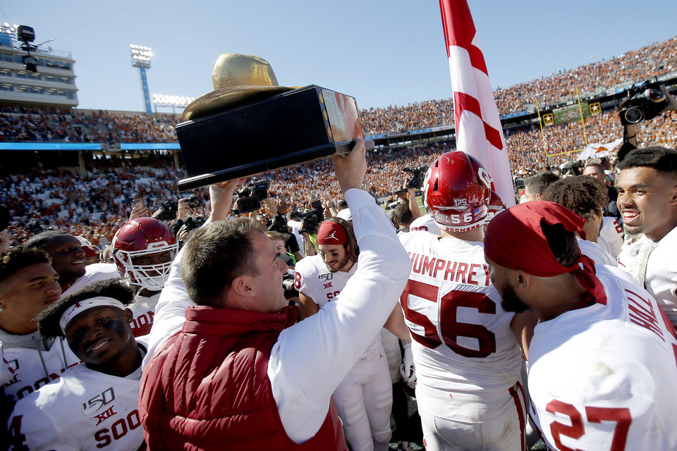 Photo - Gov. Kevin Stitt carries ou the Golden Hat after the Red River Showdown college football game between the University of Oklahoma Sooners (OU) and the Texas Longhorns (UT) at Cotton Bowl Stadium in Dallas, Saturday, Oct. 12, 2019. Oklahoma won 34-27. [Bryan Terry/The Oklahoman]