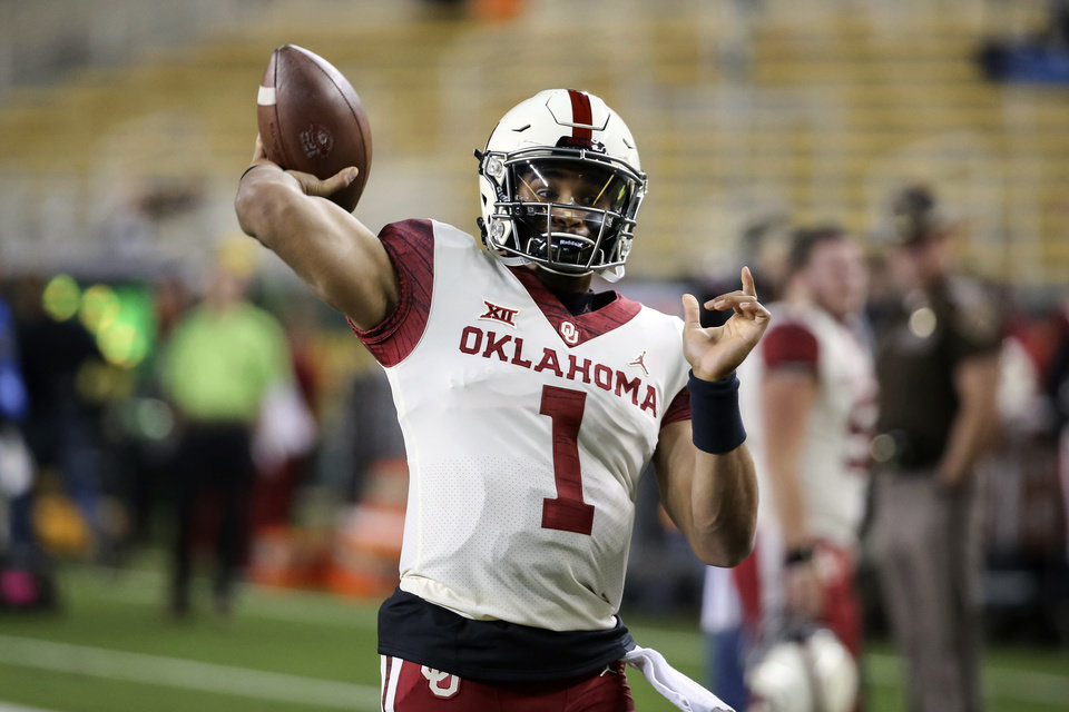 Photo - Oklahoma quarterback Jalen Hurts warms up prior to an NCAA college football game against Baylor in Waco, Texas, Saturday, Nov. 16, 2019. (AP Photo/Ray Carlin)