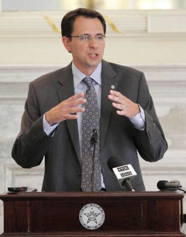 Photo - Oklahoma City University economist Russell Evans discusses a study of the economic impact of the oil and natural gas industry at a Capitol press conference Wednesday.  Garett Fisbeck - The Oklahoman