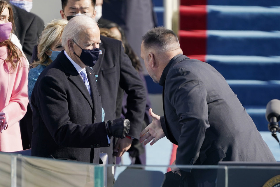 Photo - Garth Brooks shakes President Joe Biden's hand as he arrives to sing Amazing Grace during the 59th Presidential Inauguration at the U.S. Capitol in Washington, Wednesday, Jan. 20, 2021. (AP Photo/Patrick Semansky, Pool)
