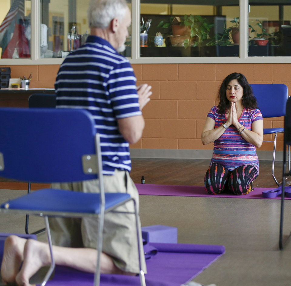 Photo -  Sara Alavi leads a therapeutic yoga class for veterans this month  at the Oklahoma City VA hospital. At left is Air Force veteran Don Bamborough. [Photo by Nate Billings, The Oklahoman]