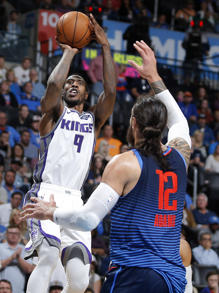 Photo - Sacramento's Iman Shumpert (9) shoots over Oklahoma City's Steven Adams (12) during an NBA basketball game between the Oklahoma City Thunder and the Sacramento Kings at Chesapeake Energy Arena in Oklahoma City, Sunday, Oct. 21, 2018. Photo by Bryan Terry, The Oklahoman