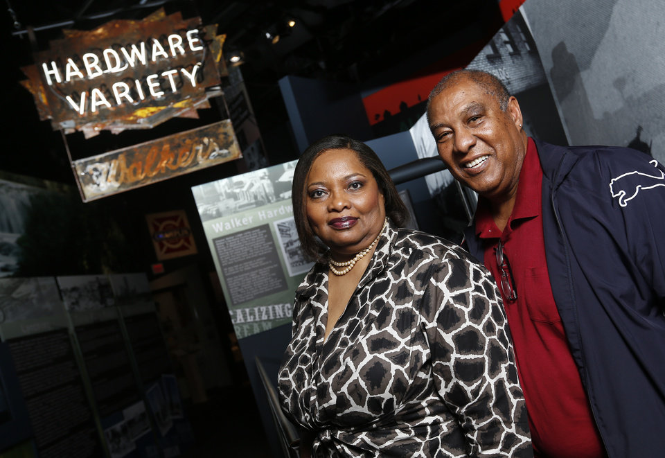 Photo -  Antoinette Roach and Bruce Fisher pose for a photo near the Walker Hardware sign in an exhibit about African American history at the Oklahoma History Center in Oklahoma City. Roach's family owned the longtime store in Deep Deuce, and she donated the sign. Fisher, administrative programs officer at the Oklahoma History Center, curated the exhibit. Photo by Nate Billings, The Oklahoman   NATE BILLINGS -