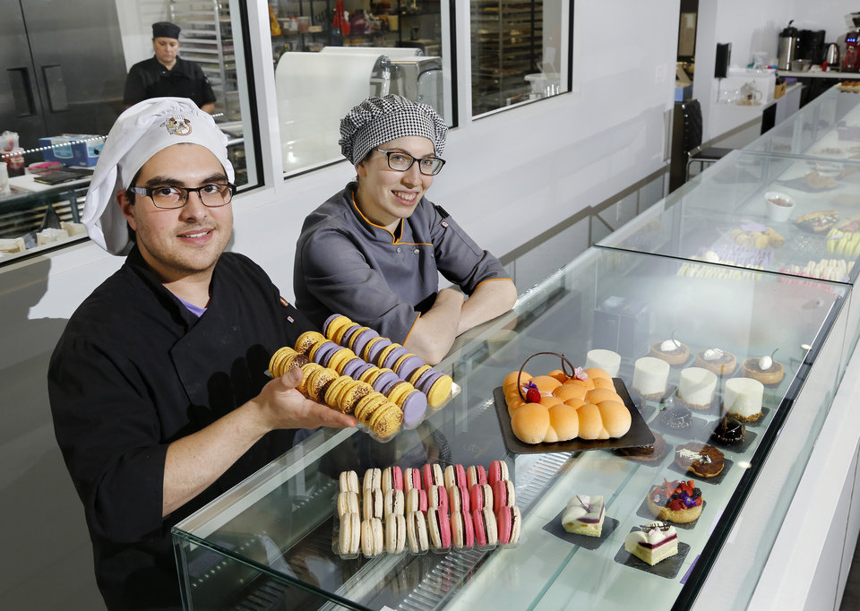 Photo -  Ganache Patisserie owners Matt Ruggi and Laura Szyld, a husband and wife team of chocolatiers and bakers, display some of the pastries, fruit tarts, elaborate desserts and European breads available for purchase at their store.