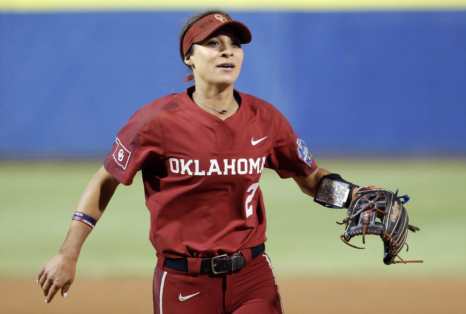 Photo - Oklahoma's Sydney Romero (2) celebrates OU's win over OSU following a Women's College World Series between Oklahoma State (OSU) and Oklahoma at USA Softball Hall of Fame Stadium in Oklahoma City,  Friday, May 31, 2019.  [Sarah Phipps/The Oklahoman]