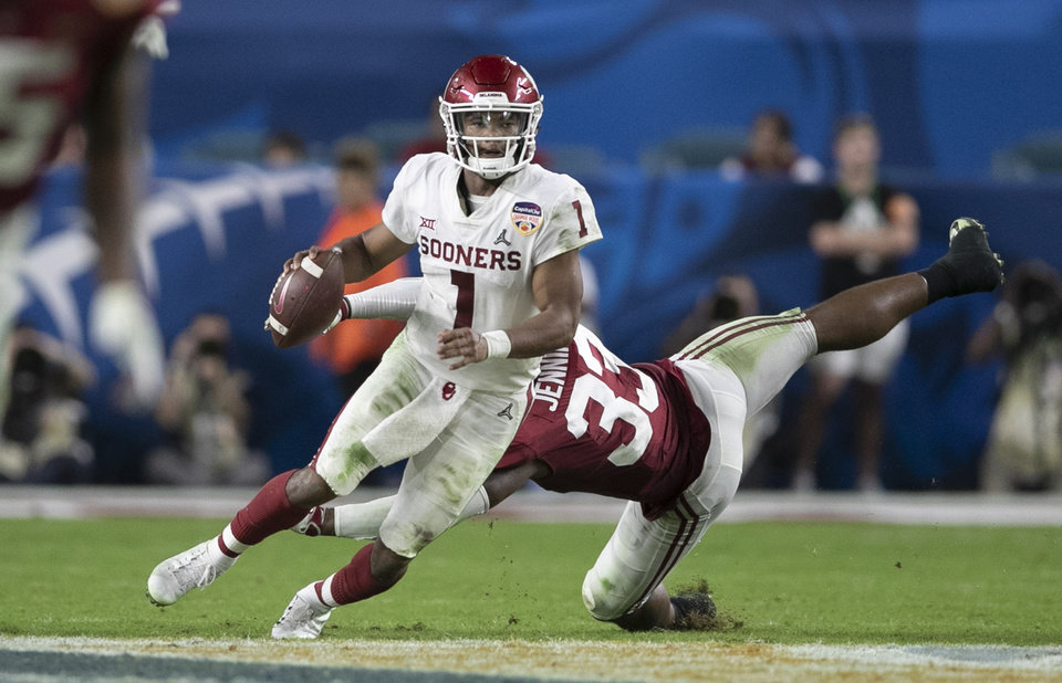 eb4ad5f0a Oklahoma Sooners quarterback Kyler Murray (1) scrambles before throwing a touchdown  to Oklahoma Sooners wide receiver Charleston Rambo (14) in the College ...