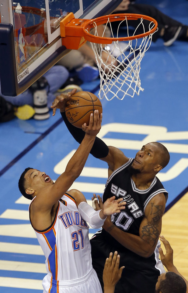 Photo - San Antonio's David West (30) blocks the shot of Oklahoma City's Andre Roberson (21) during Game 4 of the Western Conference semifinals between the Oklahoma City Thunder and the San Antonio Spurs in the NBA playoffs at Chesapeake Energy Arena in Oklahoma City, Sunday, May 8, 2016. Photo by Sarah Phipps, The Oklahoman