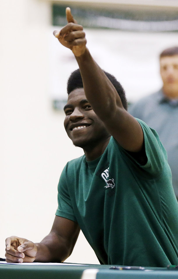 Photo - Soccer player Myles Moore points to his teammates during a national signing day ceremony at Edmond Santa Fe High School in Edmond, Okla., Wednesday, Feb. 4, 2015. Moore signed to play soccer at Oklahoma Baptist University. Photo by Nate Billings, The Oklahoman