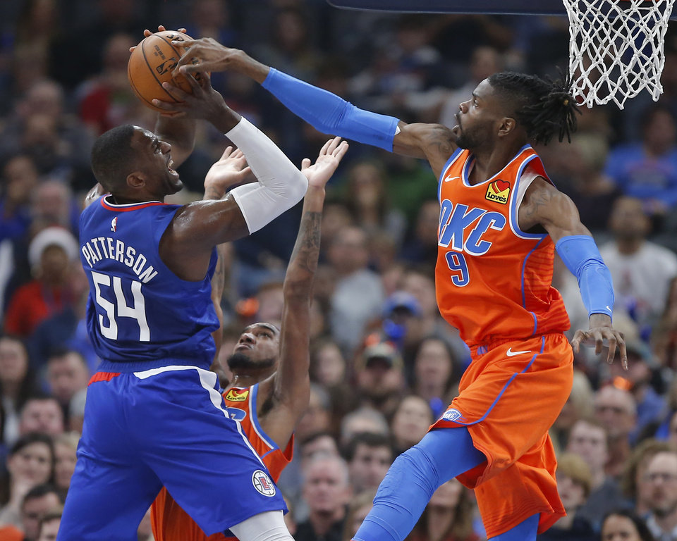 Photo - Oklahoma City's Nerlens Noel (9) and Terrance Ferguson (23) defend LA's Patrick Patterson (54) during an NBA basketball game between the Oklahoma City Thunder and the LA Clippers at Chesapeake Energy Arena in Oklahoma City, Sunday, Dec. 22, 2019. [Bryan Terry/The Oklahoman]
