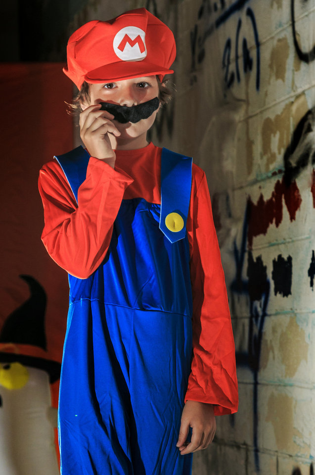 Photo - Ramey is ready to save the princess in his Mario costume.  This detailed outfit brings the video game action to a whole new level with a jumpsuit, hat and moustache. Costume from Party Galaxy.  Photo by Chris Landsberger, The Oklahoman  CHRIS LANDSBERGER