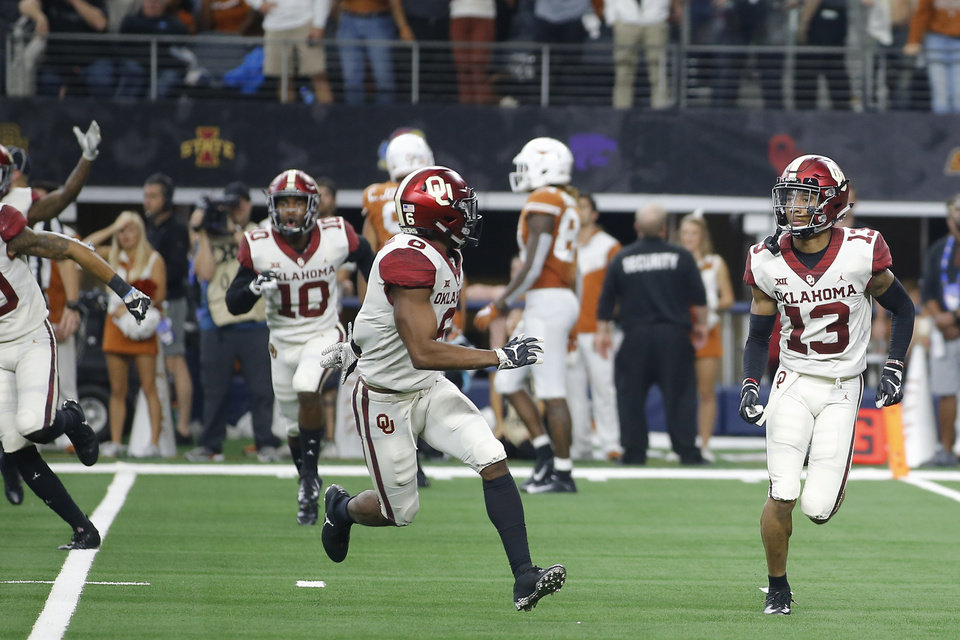 Photo - Oklahoma's Tre Norwood (13) celebrates beside Tre Brown (6) after an interception during the Big 12 Championship football game between the Oklahoma Sooners (OU) and the Texas Longhorns (UT) at AT&T Stadium in Arlington, Texas, Saturday, Dec. 1, 2018.  Oklahoma won 39-27. Photo by Bryan Terry, The Oklahoman