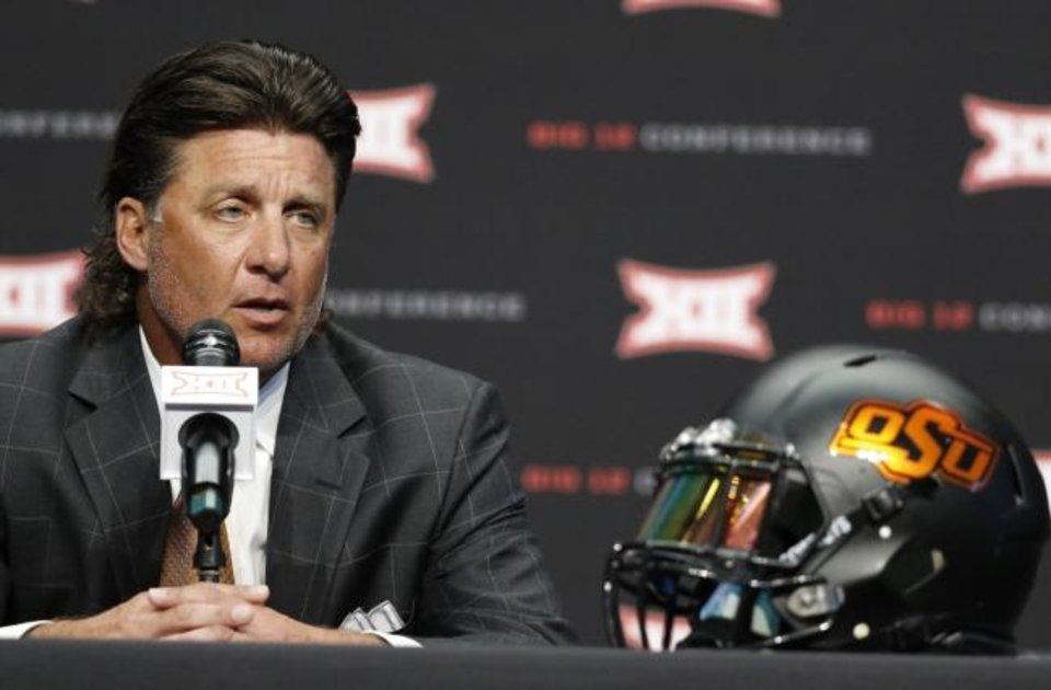 Photo -  Mike Gundy made no headlines Monday at Big 12 football media day about who will be Oklahoma State's starting quarterback. The Cowboy coach even said he is open to Spencer Sanders and Dru Brown sharing the job. [AP PHOTO/DAVID KENT]