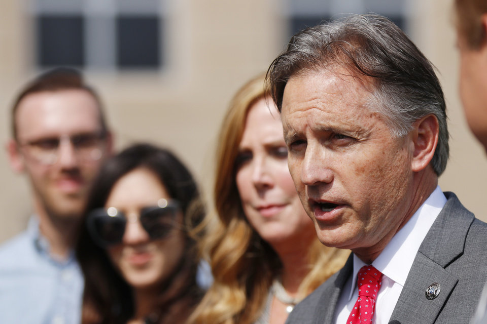 Photo -  Attorney General Mike Hunter speaks to the media in Oklahoma City after his runoff opponent conceded Wednesday. [Photo by Doug Hoke, The Oklahoman]