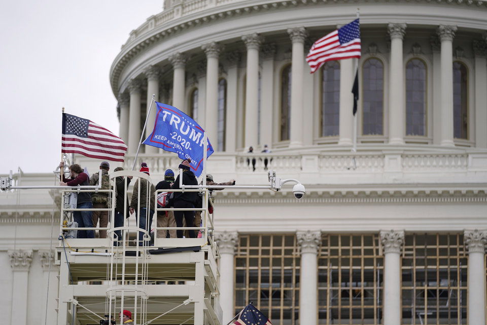 Photo - Trump supporters rally Wednesday, Jan. 6, 2021, at the Capitol in Washington. As Congress prepares to affirm President-elect Joe Biden's victory, thousands of people have gathered to show their support for President Donald Trump and his claims of election fraud. (AP Photo/Julio Cortez)