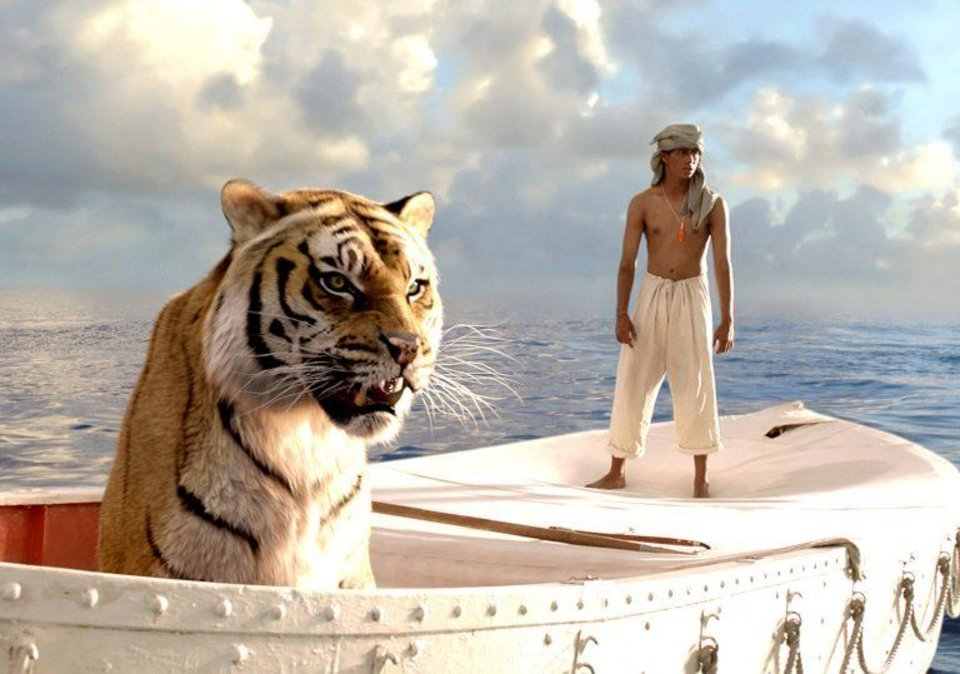 "Photo - The centerpiece of the Oklahoma City Philharmonic's Oct. 5 Classics concert will be Canadian composer Mychael Danna's Oscar-winning suite from the acclaimed 2012 film ""Life of Pi,"" about a young Indian man who survives a shipwreck but ends up adrift in a lifeboat with a Bengal tiger. [Fox 2000 photo]"