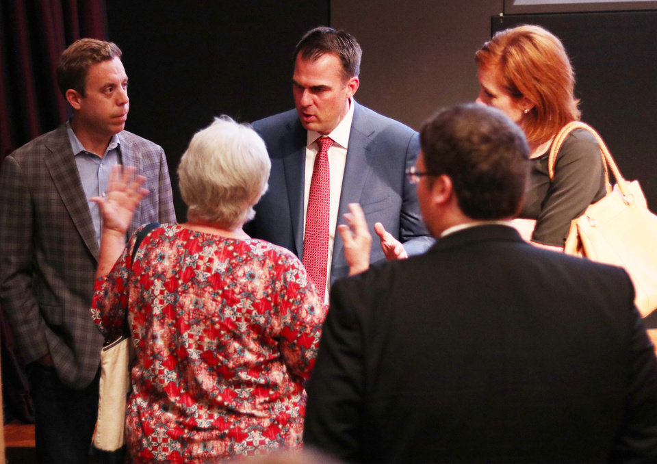 Photo - Kevin Stitt talks with a women after The Oklahoman's Gubernatorial Forum at the Oklahoma City Museum of Art, Monday, September, 24, 2018.  Photo by Doug Hoke, The Oklahoman