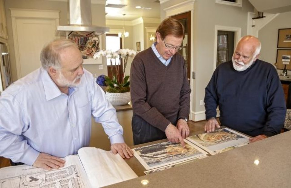 Photo -  William Canfield, Michael Biddinger and Mel Cannon, from left, look at construction plans  for new homes at The Hill in Deep Deuce in this 2017 photo. [OKLAHOMAN ARCHIVES]